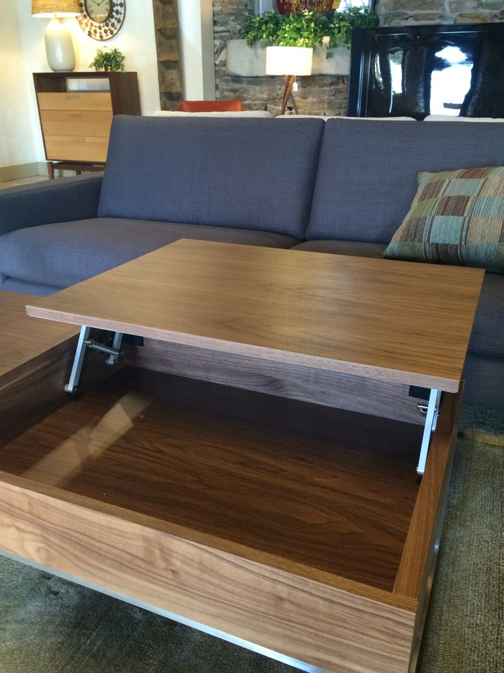 Who wouldn't love this functional coffee table with inside storage and a  place to