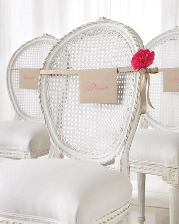 Tie your programs to chairs and dress them up with some fresh blooms