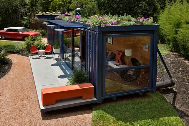 shipping container studio with a living green roof perfect for a backyard retreat