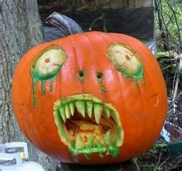 zombie pumpkin maybe with a brain or leg in his mouth? Oooh and worms.