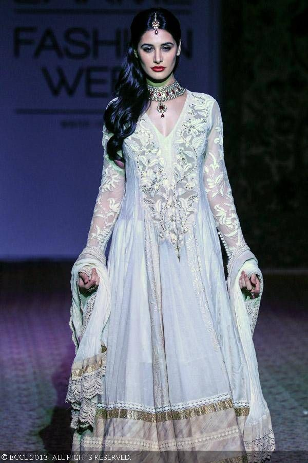 Nargis Fakhri showcases a creation by designer Ritu Kumar on Day 5 of the Lakme Fashion Week (LFW) Winter/Festive 2013, held at Grand Hyatt, Mumbai, on August 26, 2013.