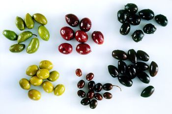 Greek olives are known the world over for their variety, flavors, and colors. Learn various methods of home curing.