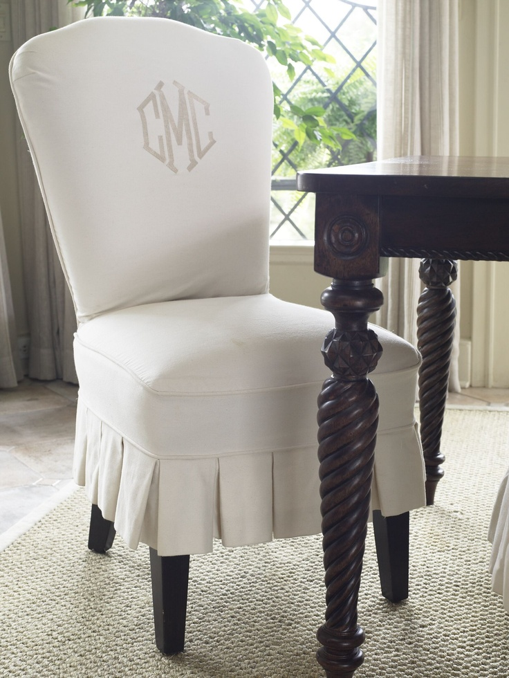 A favorite decorating tip of mine - and a tried & true one - is monogramming. It adds a personal touch to your sheets, towels, or a slipcovered chair in your dining room.  Photo (C) Nancy E. Hill from my book 'The Soul of a House'