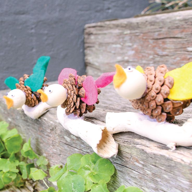Little birdies made of Pinecones, Felt, Driftwood, Wiggly Eyes and Bell Cups