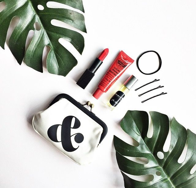 Crazy chic flatlay with Nars Audacious, Ampersand Clutch & Mmerci Encore's Glow Elixir.