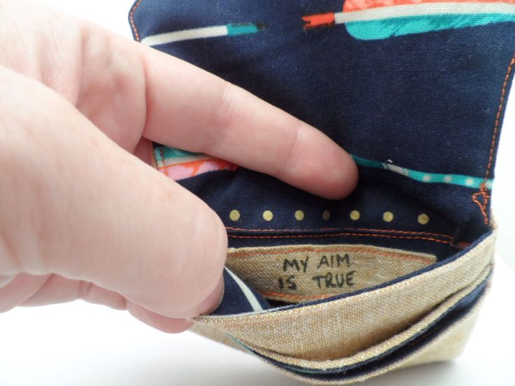 """Hidden message """"My aim is true"""" linen and cotton wallet 