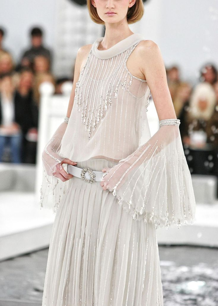 Chanel. I adore this dress but I hate that the model who is wearing it has to look so sick and unreal....