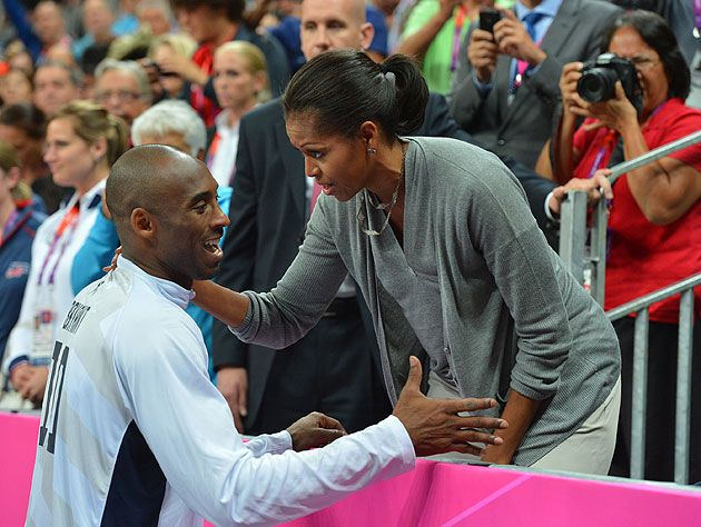 The first lady sets Kobe straight. (Getty Images)  She's such mom!!!