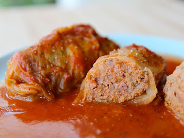 Learn to make stuffed cabbage leaves with a savory meat and rice filling with a classic tart and sweet tomato sauce. Kosher, Meat, Gluten Free.