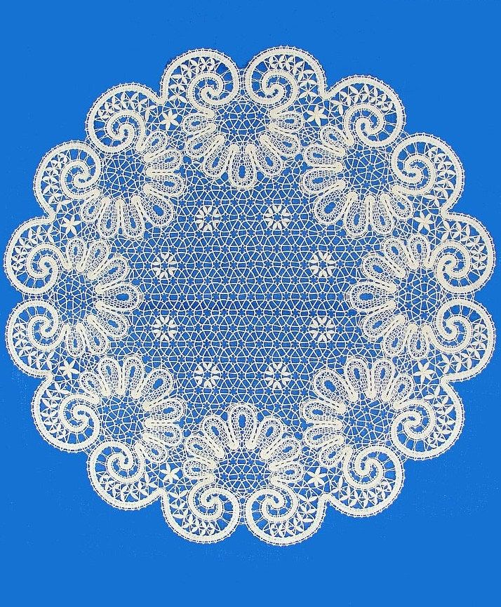 A round doily is made of Russian bobbin lace. #Russian #bobbin #lace