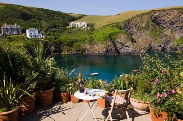A delightful cottage terrace garden in Cornwall. Such a view!