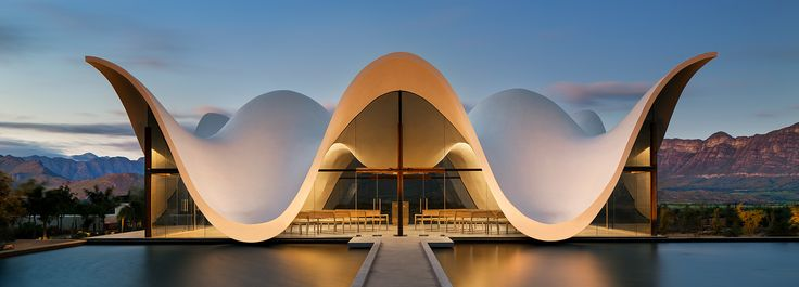 steyn studio's bosjes chapel in south africa is crowned with a sculptural roof canopy