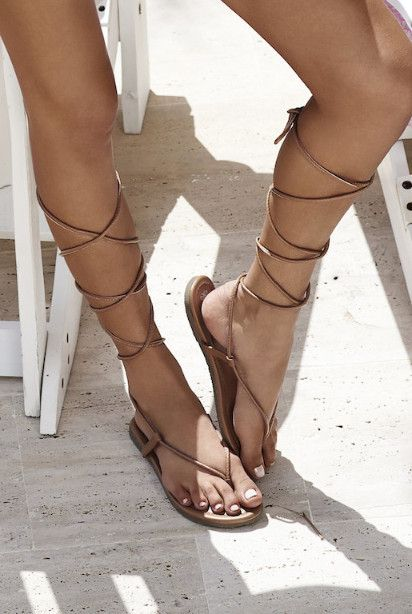 The PilyQ Gladiator Sandal in Black/Gold are the perfect compliment to any beach day look. The delicate, lace-up wrap tie closure create an edgy yet feminine feel. Man made upper and sole. We love to