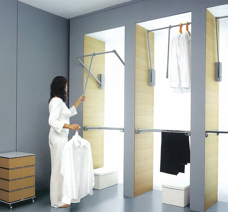 Pull-down hanging rail in full height built-in wardrobe - maximise the reachable space. Could have drawers underneath and rail above, as long as still space for long dresses somewhere.