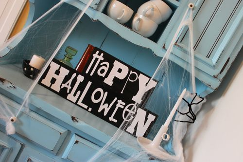 Maybe the thing that makes this picture so awesome is the cupboard itself, not the Halloween decorations ;)
