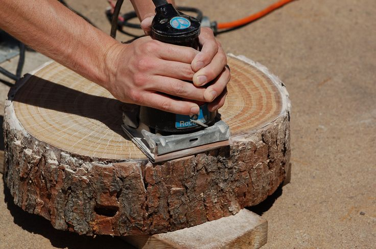How to make tables from slices of tree.  I had read that the wood needed to be kiln dried but this just uses fresh cut wood.