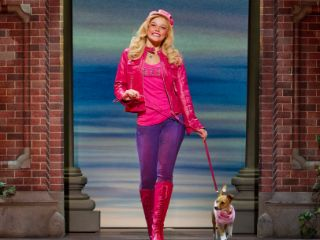 Elle Woods (Faye Brookes) and Bruiser. Credit - Johan Persson