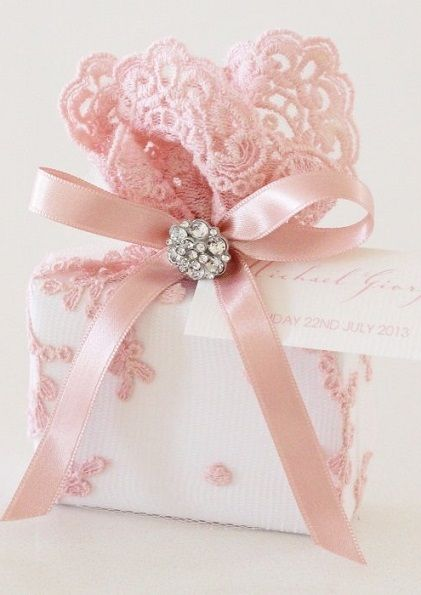Embellish your gift wrapping with pretty ribbon, tulle and embellishments #giftwrap #pink