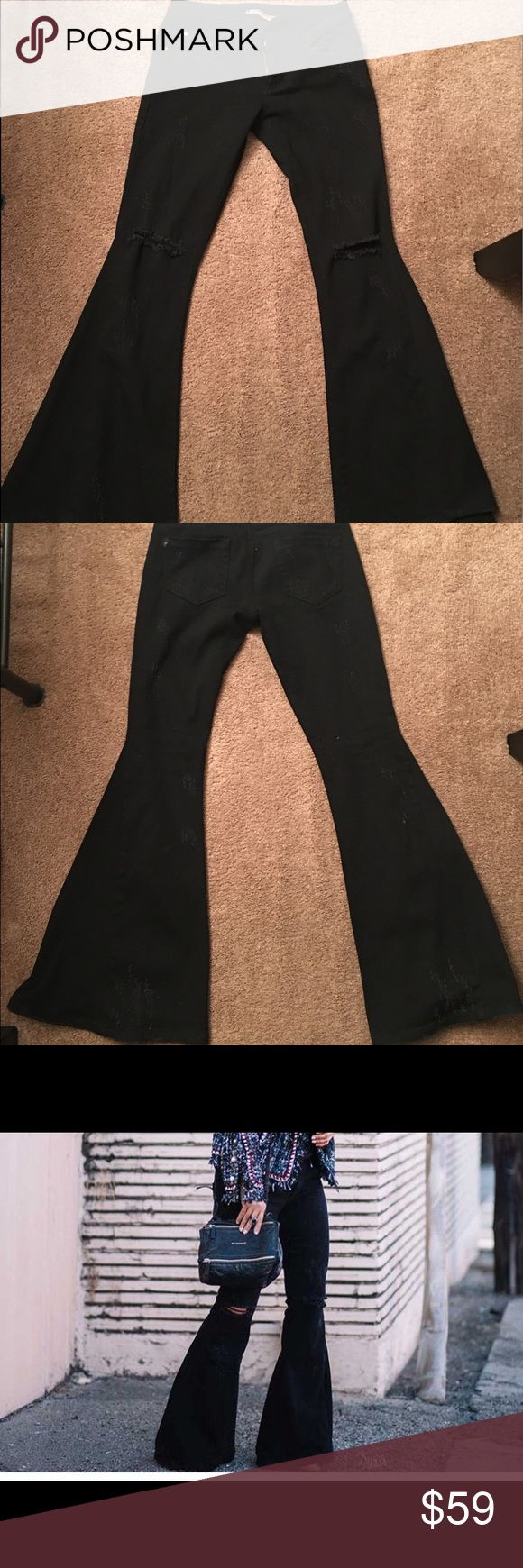 Black Flare Jeans (never worn) Size 6. Not long enough for me and can't return. Bought these from an online boutique. Came with no tags but never worn outside of trying them on. Pictures shows how the look on. Very few were sold, so this is a great unique buy!!! Jeans Flare & Wide Leg