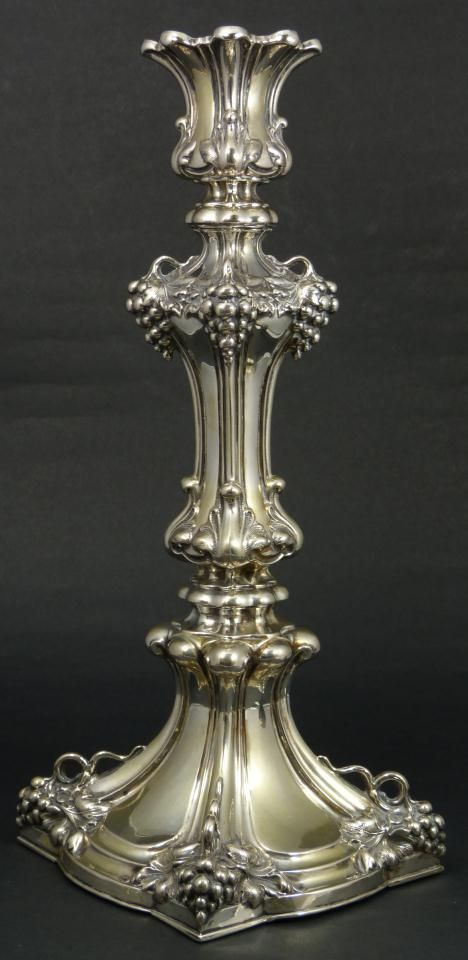 "FINE EUROPEAN STERLING GRAPE CLUSTER CANDLESTICK Beautiful ornate sterling silver grape candlestick. Exquisitely designed throughout depicting grape clusters and vines with scrolled designs. Holds 12Lo6 and PW workmaster marks to side of base. 18th/19th century. Measures 14"" height x 6"" width x 6"" depth (35.6cm x 15.2cm x 15.2cm). Total weight of 21.525 ozt / 669 grams."