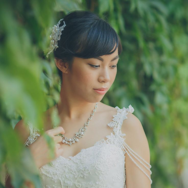 a bride from Hong Kong at one of Prague's Castle gardens www.KurtVinion.com