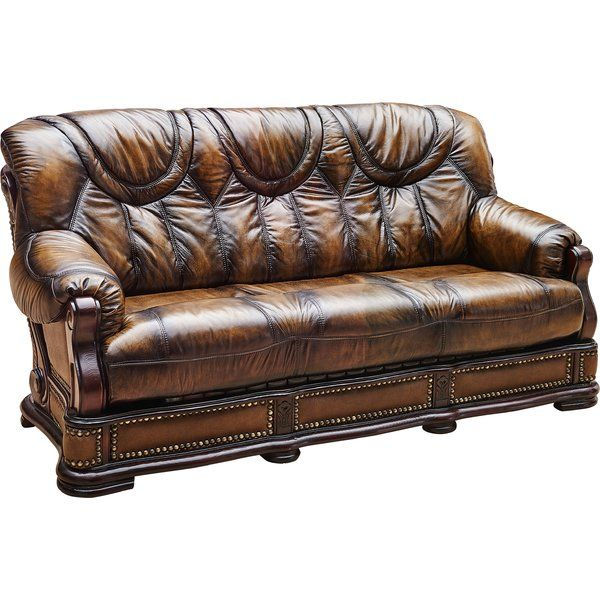 this carrie sofa is accented with wood framing and wrapped in finest genuine italian leather with the leather match material