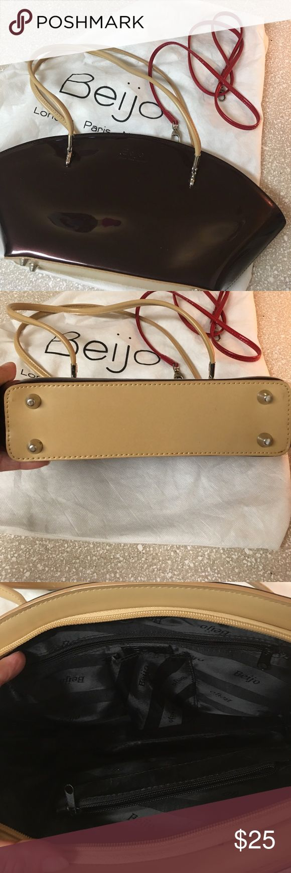 Beijo bag Like new.  Has extra red strap to attach for a shoulder bag Bags