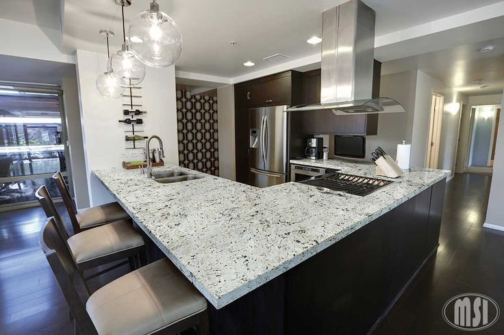 Neutral, but not boring! Our Snowfall Granite countertop is so beautiful you can't help but stare! Bonus: It works great with a range of finishes, design styles, and decors!