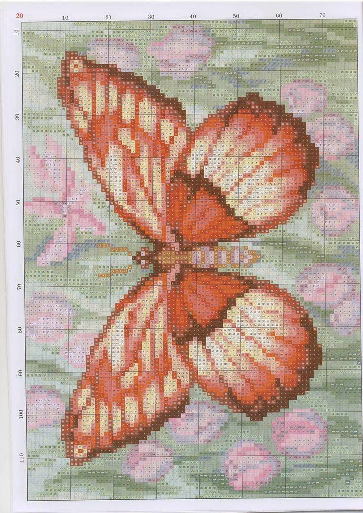 Oranje vlinder met zachte tulpen achergrond