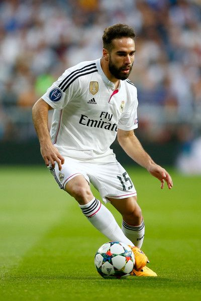 Dani Carvajal Photos Photos - Dani Carvajal of Real Madrid CF in action during the UEFA Champions League quarter-final second leg match between Real Madrid CF and Club Atletico de Madrid at Bernabeu on April 22, 2015 in Madrid, Spain - Real Madrid CF v Club Atletico de Madrid - UEFA Champions League Quarter Final: Second Leg
