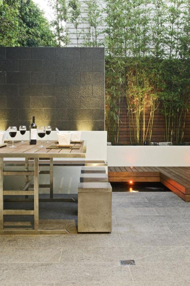 ideen für Sichtschutz wand Bambus-Blumenkübel Sitzgruppe hocker