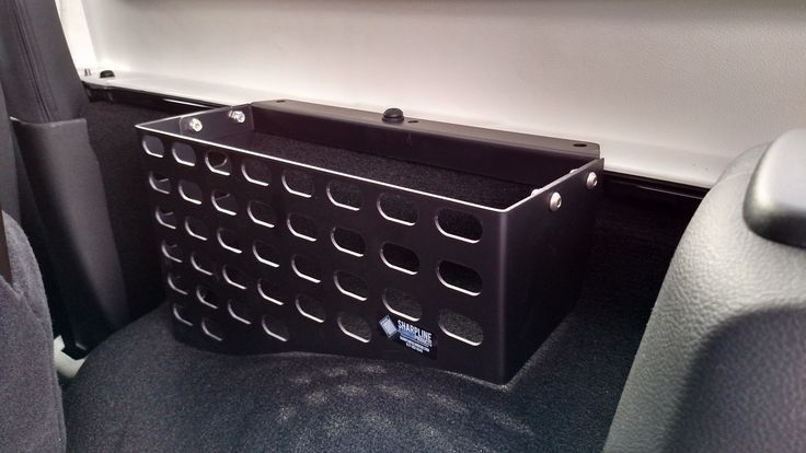 Easily access your rear fender organizer from the back seat of your Jeep® Wrangler Unlimited.