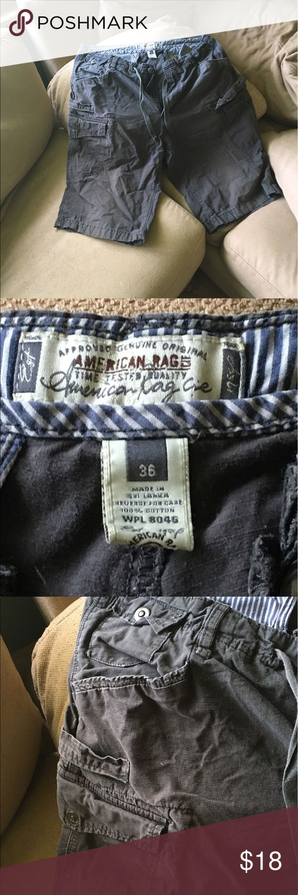 Classic American Rag Men's Cargo Shorts Great cargos. Just perfect. They're that olive green/black/gray color that men like. Who knows what color they are . . . They're too small for my son/s now. Worn maybe twice. Perfect condition. All the bells and whistles. American Rag Shorts Cargo