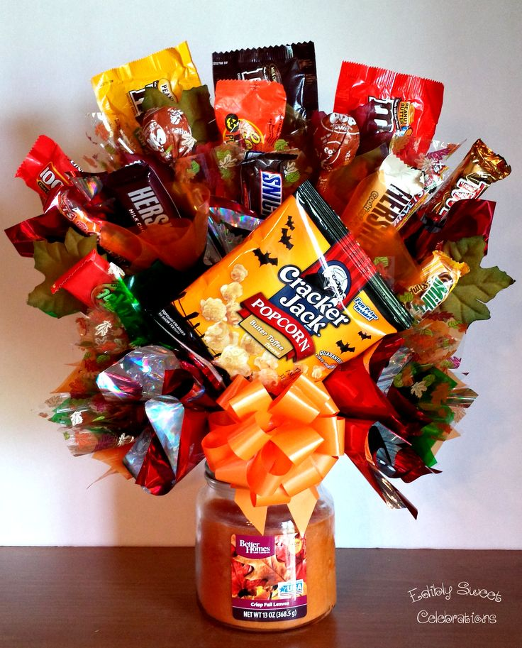 2 gifts in one fall autumn candy bouquet on top of a candle jar.