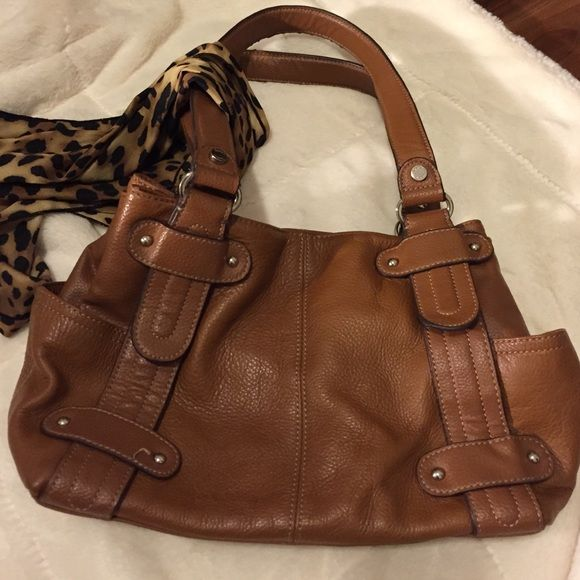 SALE Tignanello handbag Gently used genuine leather handbag.  Two side pockets and lots of compartments inside to keep your belongings organized. Tignanello Bags Totes
