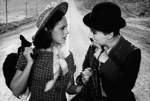 """Smile!"" Charlie Chaplin and Paulette Goddard in Modern Times"