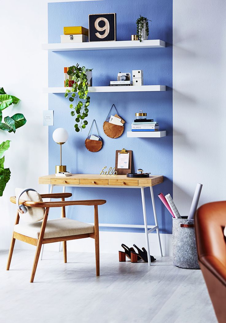 Create a functional home office that is equal parts inspiring and calming thanks to a soft blue colour palette, warming touches of timber and plenty of indoor plants. Photo: Andrew Finlayson | Styling: Fiona Michelon | Story: homes+