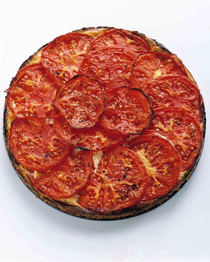 Tomato-Ricotta Tart | Martha Stewart Living - This savory tart boasts a crust made of fresh breadcrumbs, a custard-like filling of ricotta, Parmesan, eggs, and basil, and beefsteak tomato topping. Feel free to prepare it in advance, as it's equally delicious at room temperature as it is warm.