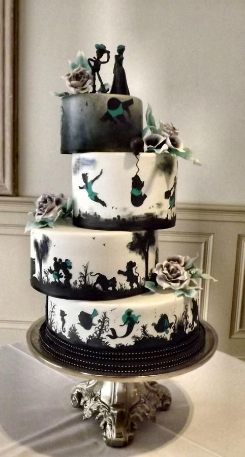 Disney Silhouette Wedding Cake by Storyteller Cakes - http://cakesdecor.com/cakes/221192-disney-silhouette-wedding-cake