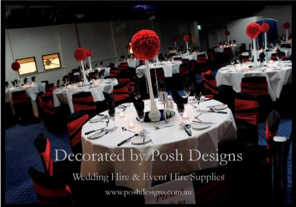 Red lycra bands, black lycra chair covers, white tablecloths, red rose ball table centres with mirrored tiles all for hire. Australia wide. Visit www.poshdesigns.com.au for more photos and info, or email lisa@poshdesigns.com.au for pricing packages