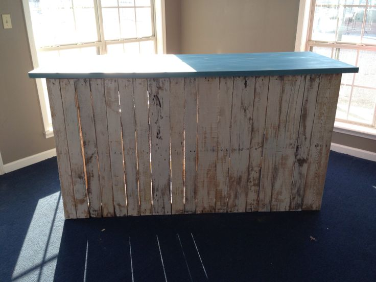 Pallet board distressed counter for boutique
