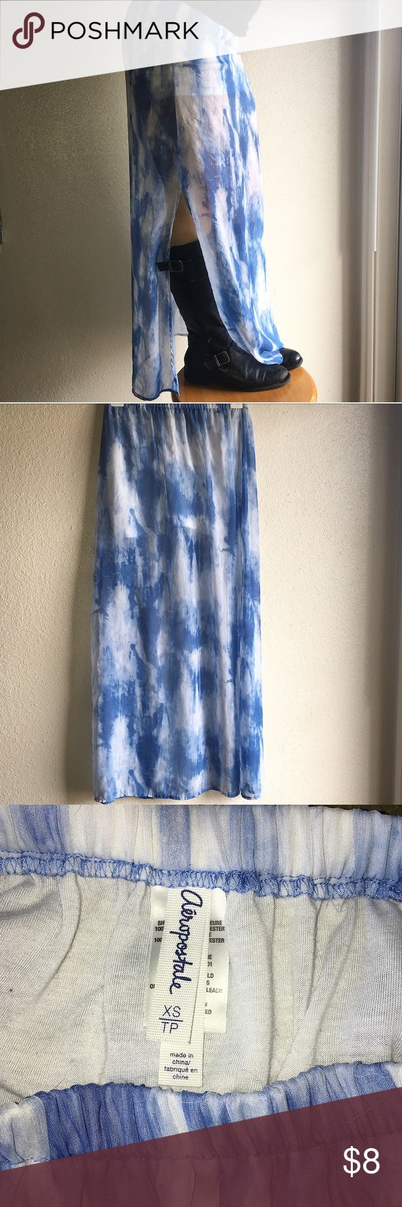 Sheer Blue & White Tie dye Skirt This beautiful skirt is 100% polyester. It has a white slip lining the top of the skirt to cover all of the necessary parts. This hardly worn skirt is great for every style. Goes great with boots or sandles due to the side slits on both sides. Aeropostale Skirts Maxi