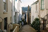 st ives looking up fish street downalong st ives low tide at the ...