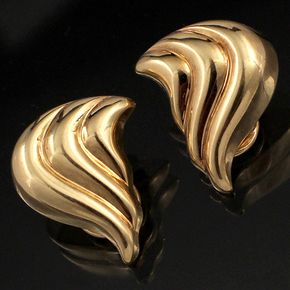 Shop 14KY Stylized Swirled Teardrop Omega Clip Earrings and other jewelry, art, coins, rugs and real estate at www.aantv.com