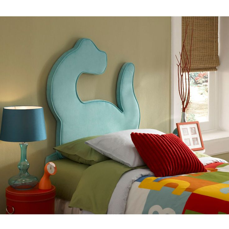 oh my goodness :) I wish I could make something like this dino headboard. I just think you could find so many cute fabrics to match this, that you could decorate this room forever!