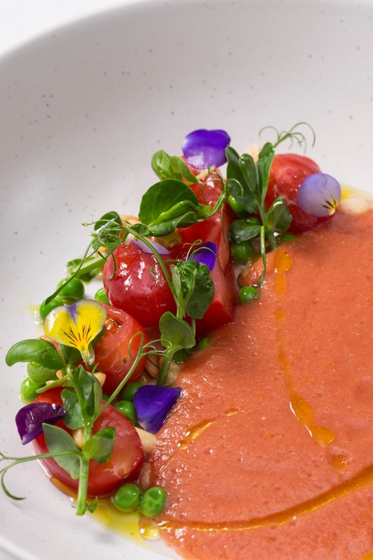 In this gazpacho recipe, Paul Welburn adds depth of flavour by infusing the soup with cucumber, red pepper and basil before blending. A fantastic tomato soup recipe for spring and summer, working perfectly as a healthy starter for dinner parties.