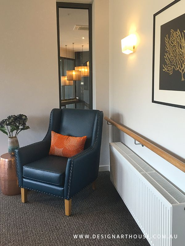 A fabulous little corner to take time out and relax.  Custom armchair with bronze studding detail for aged care residence.