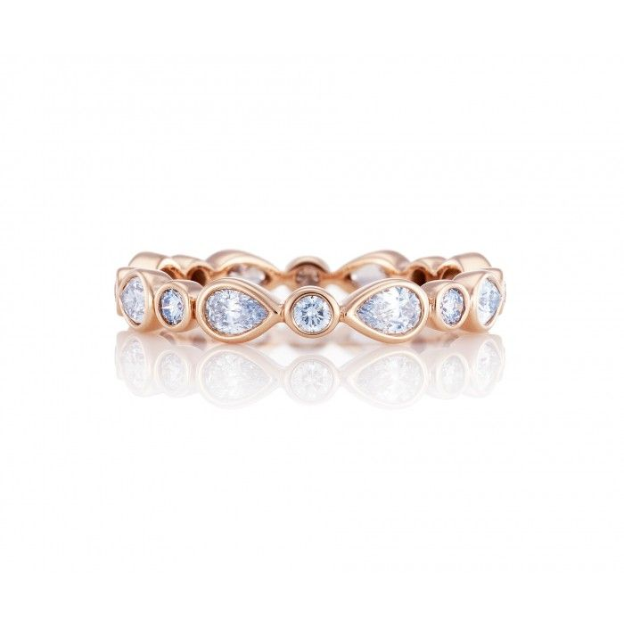 De Beers Pink Gold Petal Band Symbolic of the rejuvenation of spring, delicate diamond petals flourish in a pink gold band intricately set with sixteen specially selected pear-cut and round brilliant diamonds.