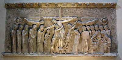 Benedetto Antelami, Deposizione dalla croce, 1178, Duomo di Parma. La scultura romanica narra storie sacre ai fedeli. La rappresentazione della fiugra umana è realistica, anche se deformata.