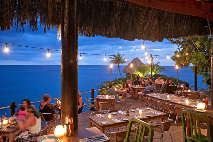 Outdoor seating at the Rockhouse Hotel's restaurant in Negril. (Photo: Robert Rausch for The New York Times)